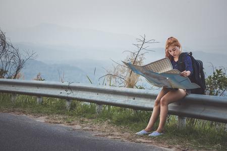 woman  travel. Female travelers travel nature mountain map navigation
