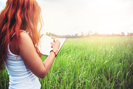 Women write notes Nature trails, mountains, forests. Writer. Asian women