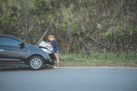 woman  travel. Female travelers travel nature mountain map navigation. Travel by car