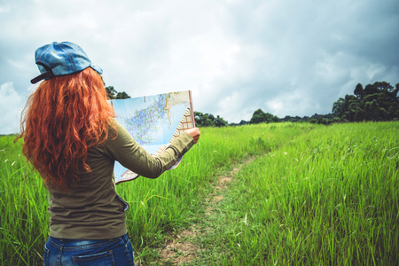 woman  travel. Asian women view map travel nature on the meadow