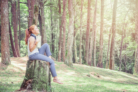 Read women relax in the park, pine forest, holiday forest.
