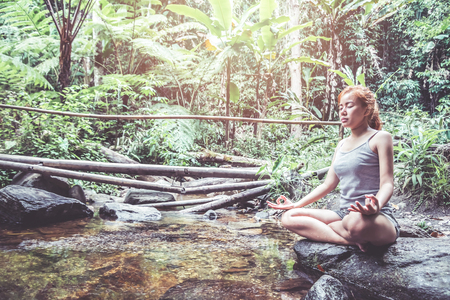 woman asia travelers travel nature Forests waterfall. Meditate on yoga