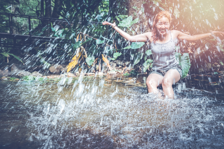 woman travelers travel nature Forests, relax play waterfall Stock Photo