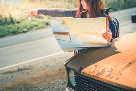 Drive old car Travel. Female travelers travel nature mountain map navigation