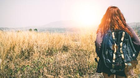 Female travelers travel nature mountain. Evening sun