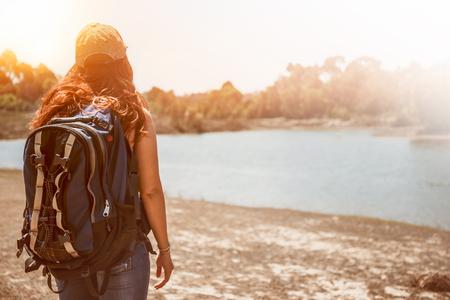 Couple hugging on natural grassland on the mountain. Morning sun shines through