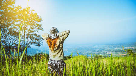 Asian women travel relax in the holiday. green pasture on the Mountain. Thailand Reklamní fotografie