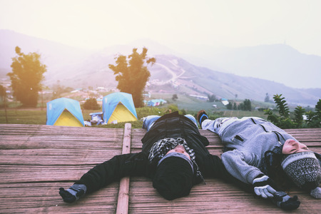 Lover women and men asians travel relax in the holiday camping. watch atmosphere in the morning. Thailand 写真素材