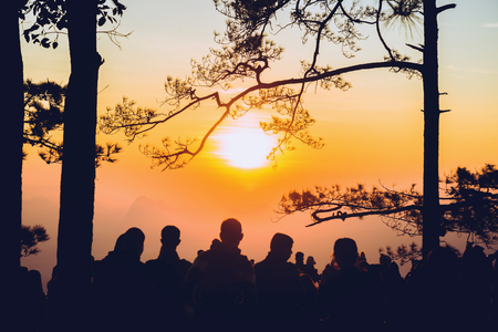 People watching Sunrise in the morning. Tourists travel relax in the holiday. photograph sunrise in the morning among people. Thailand