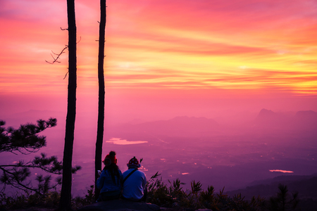 Lover women and men asians travel relax in the holiday. watching Sunrise in the morning. In the winter. In Thailand Imagens