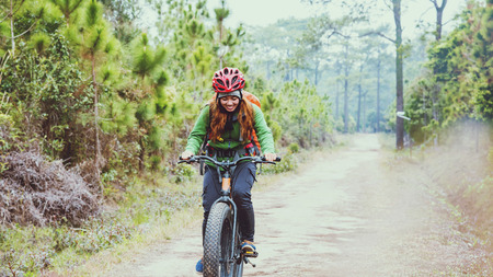 Asian women Travel photograph Nature. Travel relax ride a bike Wilderness in the wild. Thailand  Stok Fotoğraf