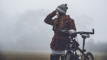 Asian woman travel  Nature. Travel relax ride a mountain bike Wilderness in the wild. Thailand