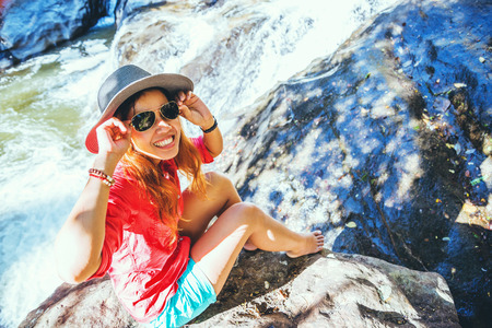 Asian woman travel nature. Travel relax. At Waterfall Use summer. In Thailand