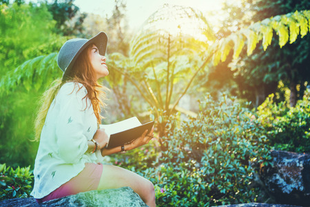 Asian woman travel nature. Travel relax. Study read a book. Nature Education Write a note At public park in summer. In Thailand Stockfoto