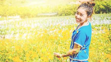 Asian woman travel relax in the holiday. Flower pasture on the Mountain in summer. Thailand