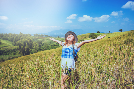 Asian woman travel relax in the holiday. Stand natural touch mountain field summer. In Thailand Stock Photo