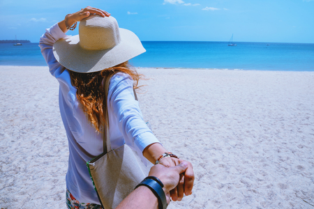 Asian lover couple woman and man travel nature. Travel relax. Play sea water on the beach. In the summer. Thailand