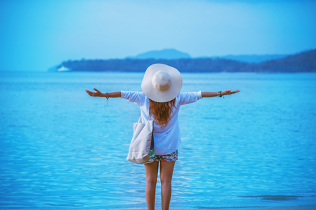 Asian woman travel nature. Stand relax on the beach. In the summer