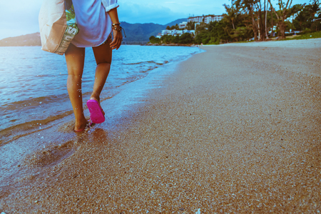 Asian woman travel nature. Travel relax. Walking on the beach. In the summer
