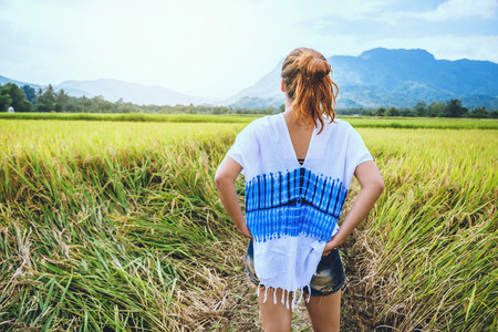 Asian woman travel relax in the holiday. Stand natural touch mountain field summer. In Thailand 스톡 콘텐츠