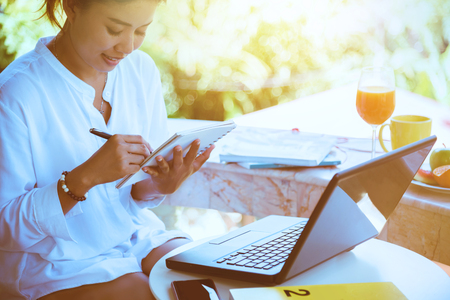woman sitting work writing record in the holiday Stockfoto