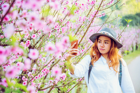 woman asian travel nature. Travel relax. photographed in a flower garden.