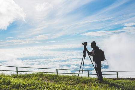 man asians travel relax in the holiday. Photograph landscape on the Moutain.Thailand Standard-Bild