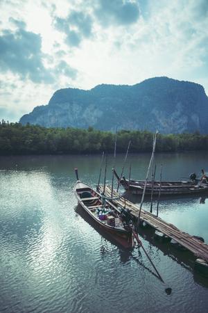 Traveling life, fishing boats, Morning sunrise, peaceful atmosphere.. Asia Thailand Stock Photo