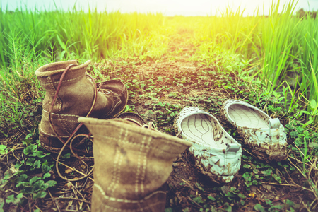 Mens shoes with women travel relax in the holiday. on a green pasture. Stock Photo