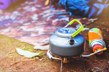 camping on the Mountain. kettle placed on a picnic gas stove.
