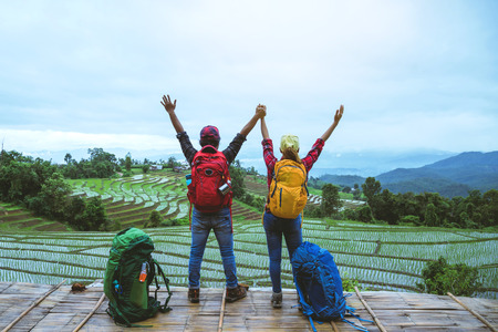 Lover woman and man Asian travel nature. Travel relax. Viewpoint Rice field of the field on the Moutain papongpieng in summer. Thailand. 写真素材