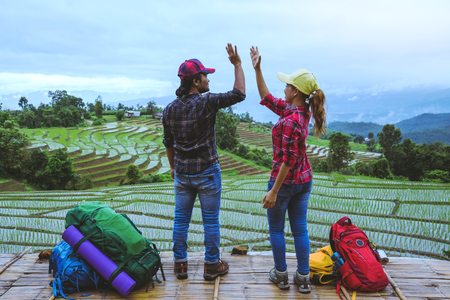 Lover woman and man Asian travel nature. Travel relax. Viewpoint Rice field of the field on the Moutain papongpieng in summer. Thailand