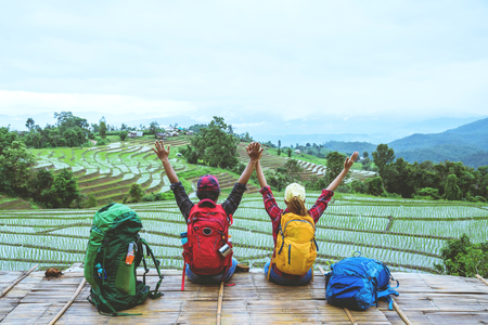 Lover woman and man Asian travel nature. Travel relax. Viewpoint Rice field of the field on the Moutain papongpieng in summer. Thailand. Stockfoto