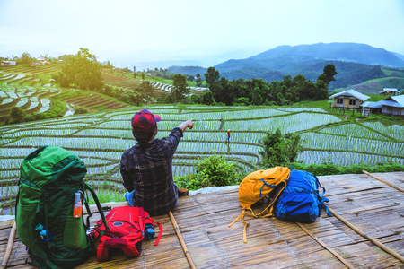 Asian man relax travel nature Viewpoint Rice field the Moutain papongpieng summer in Thailand. 写真素材
