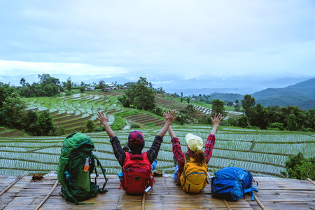 Lover woman and man Asian travel nature. Travel relax. Viewpoint Rice field of the field on the Moutain papongpieng in summer. Thailand. Stock Photo