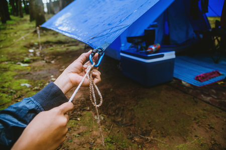 Travel nature relax in the holiday. camping on the moutainIn the wild nature. Pull the rope Carabiner. Stock Photo