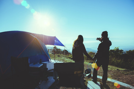 Lover woman and man asians travel relax camping in the holiday. On the Moutain. Watch the sun rise. Thailand