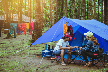 Lover asian man and asian women travel nature travel relax in the holiday. camping on the Mountain. at national park  Doi inthanon Chiangmai. in Thailand