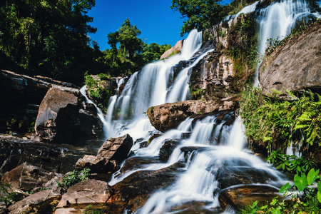 Natural background waterfall. travel nature. Travel relax waterfall. In the summer.  thailand