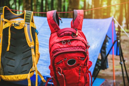 Travel nature relax in the holiday. camping on the moutainIn the wild nature. the lock force rope. tent rope buckle. at hanging backpack. Stock Photo