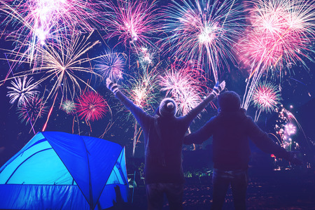 Lover women and men asians.camping on the Mountain see the fireworks on New Year's Day. Thailand