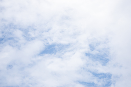Fantastic soft white clouds against blue sky background Stock Photo