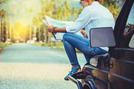 woman travel relaxing nature mountain map navigation. Sit on the car and browse the map. Stock Photo - 122183811