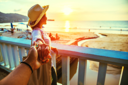 Asian lovers happy and be smile holding hands. Travel beach summer vacation.