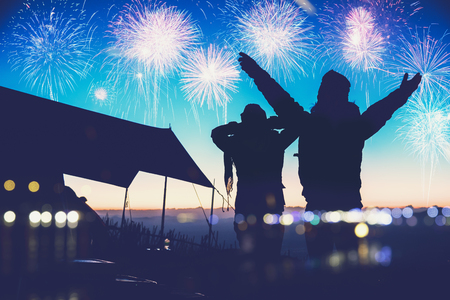 Lover women and men asians.camping on the Mountain see the fireworks on New Years Day. Thailand