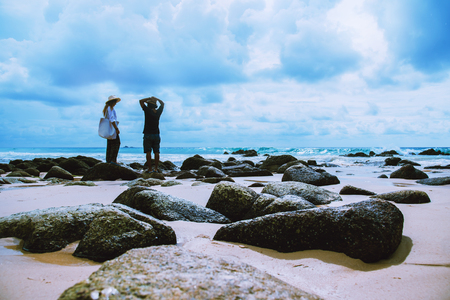 Asian lover woman and man travel nature. Travel relax. On the rocks at the sea. In the summer. Thailand Stok Fotoğraf