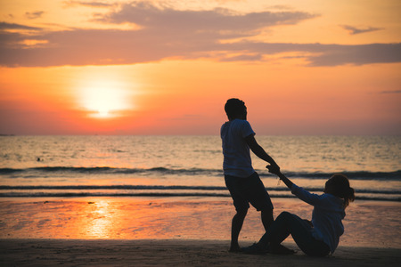 Asian lovers happy and having fun holding hands. Travel beach summer vacation.