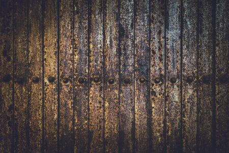 Texture background Old rusted iron gate fold Dark brown.Stainless steel