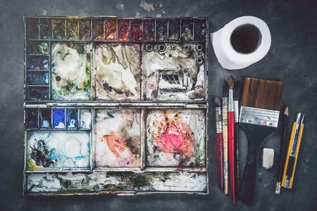 background Brushes palette with water. Equipment watercolor painting Stock Photo