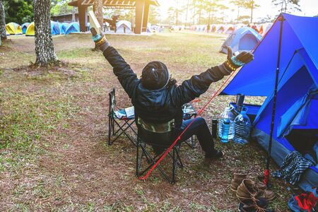 Asian man  travel relax camping in the holiday. camping on the Mountain. sit relax read a book In the chair. Thailand Stockfoto